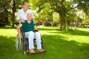 caregiver assisting senior woman on the wheelchair