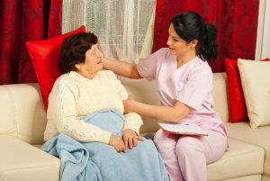 caregiver comforting the senior woman