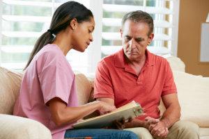 caregiver talking to the senior man