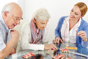 caregiver assisting the senior couple for their activities