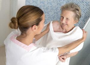 caregiver assisting the senior woman